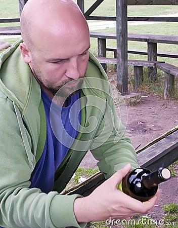 Man reading wine label