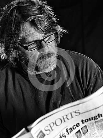 Man Reads Newspaper