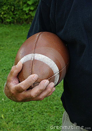 Man ready to run football