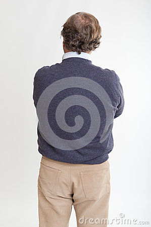 Man rear view with crossed arms