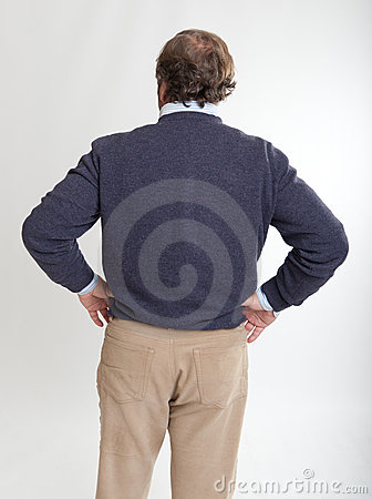 Man rear view hands on hips