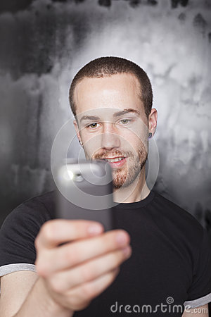 Man recording video with smartphone