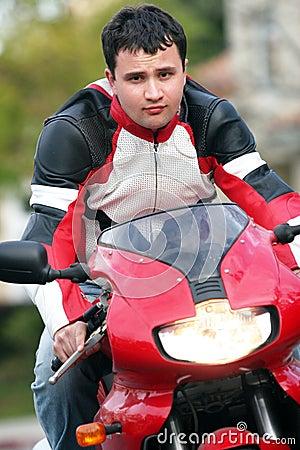 Man on a red bike