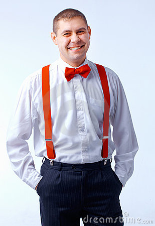 Man with red bow tie and brases