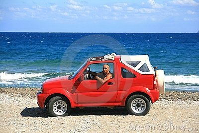 Man with red jeep