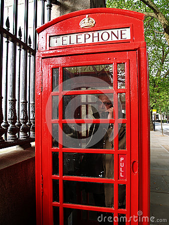 Man in a red phone booth, London