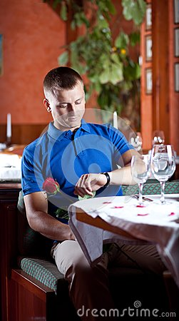 The man with red rose  in restaurant