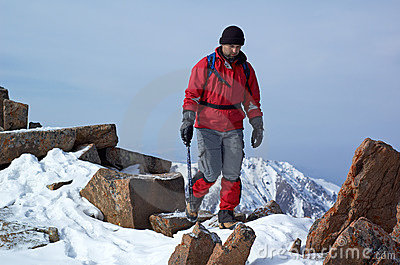 Man in red travels in mountains