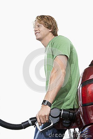 Free Man Refueling His Car Over White Background Royalty Free Stock Image - 29649936