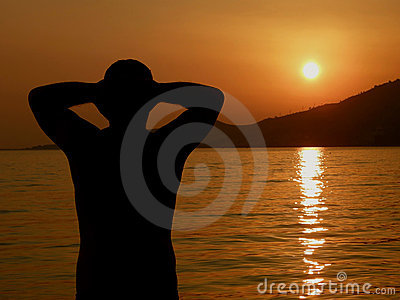 Man relax on sunset in sea