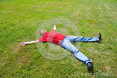 Man relaxation on a green grass