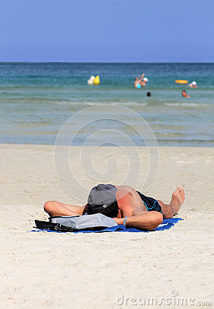 Man relaxing on beach in summer Editorial Stock Photo