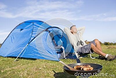 Man relaxing on camping trip