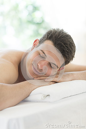 Man Relaxing At Health Spa