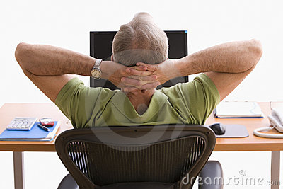 Man Relaxing at His Desk