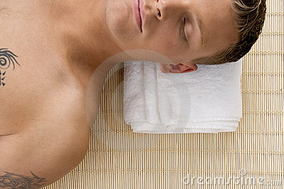 Man relaxing with his eyes closed at spa