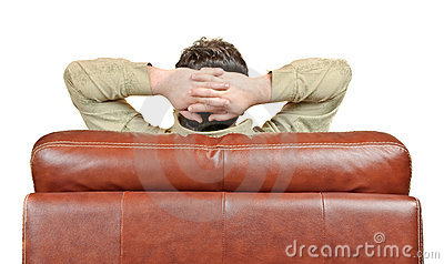 Man relaxing in leather armchair back view