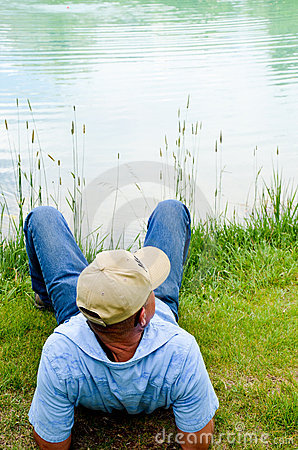 Man Relaxing At Pond