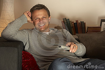 Man Relaxing With Remote Control