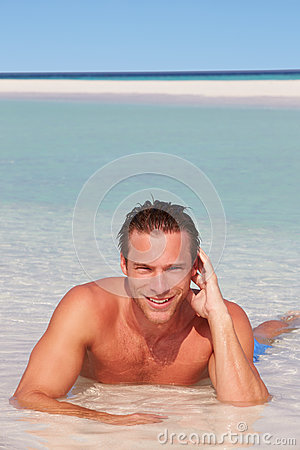 Man Relaxing In Sea On Beach Tropical Beach