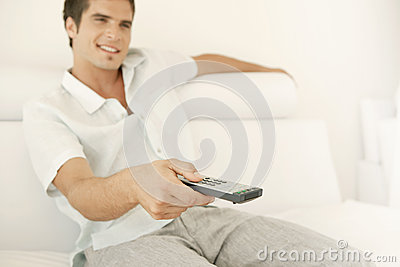Man Relaxing on Sofa with Remote