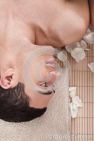 Man relaxing in spa salon