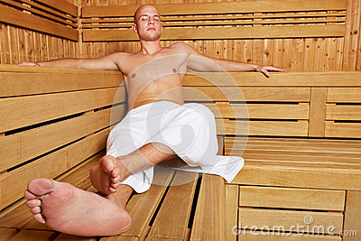 Man relaxing in steam sauna