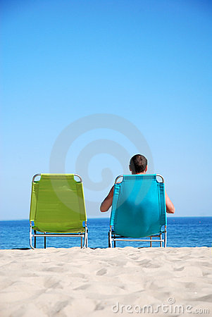 Man relaxing on sunbed