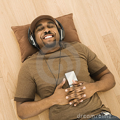 Free Man Relaxing To Music. Royalty Free Stock Photo - 4489305