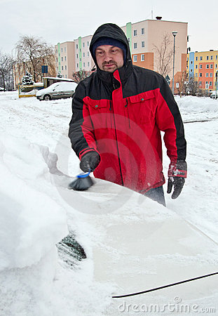 Man removing snow from car