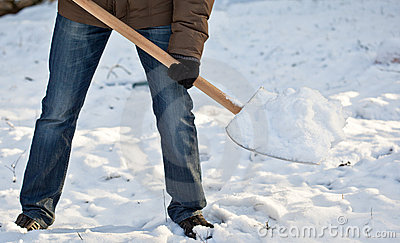 Man removing snow from a driveway
