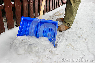Man removing snow from the sidewalk
