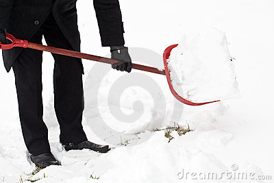 Man removing snow after snowfall