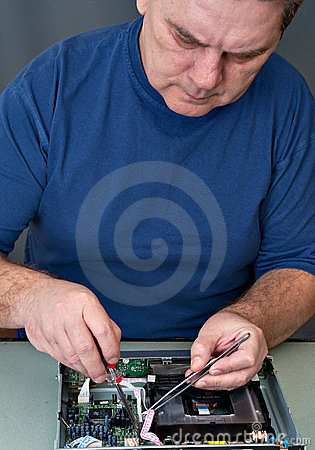The man repairing DVD a player