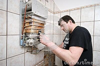 Man repairing gas furnace