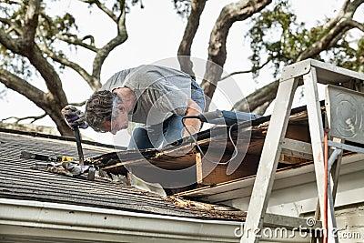 Man Repairing Rotten Leaking Roof