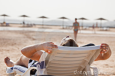Man resting in beach chair