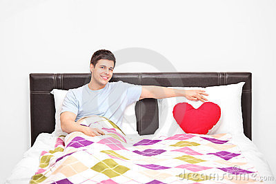 Man resting and a heart shaped pillow