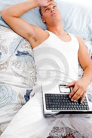 Man resting with laptop