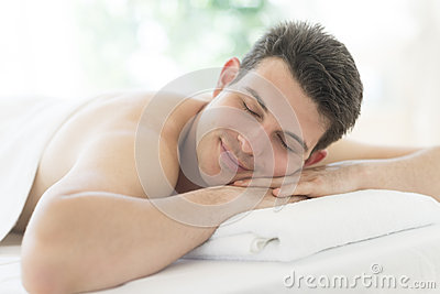 Man Resting On Massage Table At Health Spa