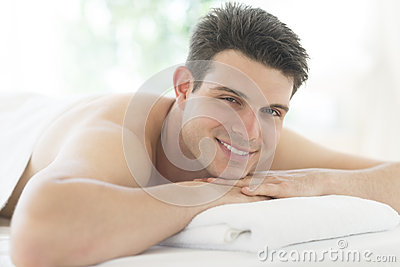 Man Resting On Massage Table At Spa