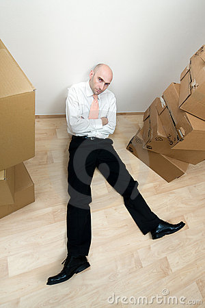 Man rests near stack of boxes