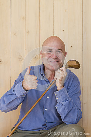 Man with retro golf stick