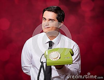 Man with retro phone
