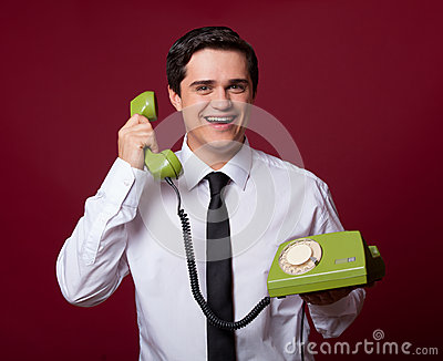 Man with retro phone