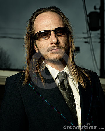 Man in Retro Suit Wearing Sunglasses