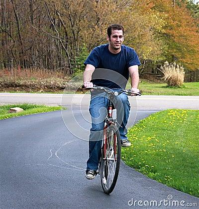 Free Man Riding Bicycle Royalty Free Stock Image - 14075246