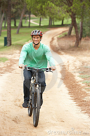 Man riding bicycle in park