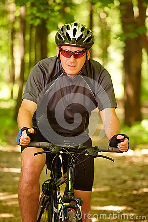 Man riding bike in forest