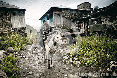 Man  riding the horse in Ushguli Editorial Photography